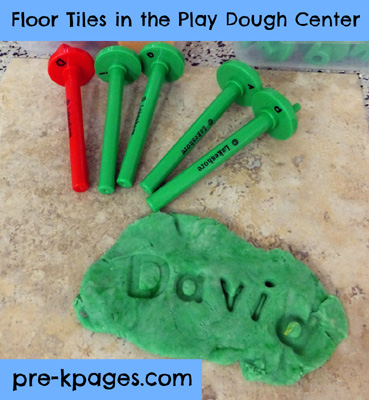 Floor tiles in the play dough center via www.pre-kpages.com