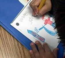 child writing book