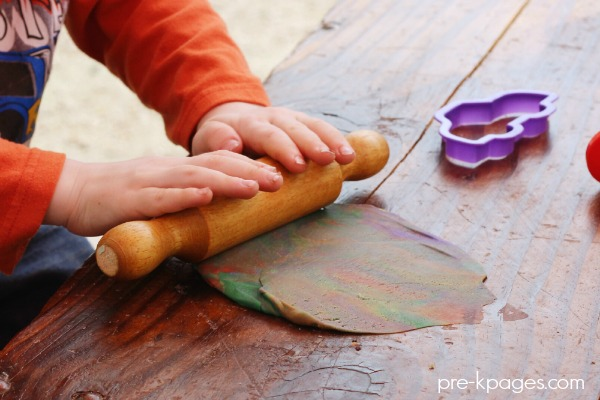 Rolling Play Dough with Rolling Pins in Preschool