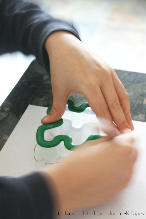 Dissolving gingerbread man science activity tracing cookie cutter