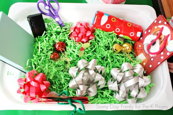 gift wrap sensory bin