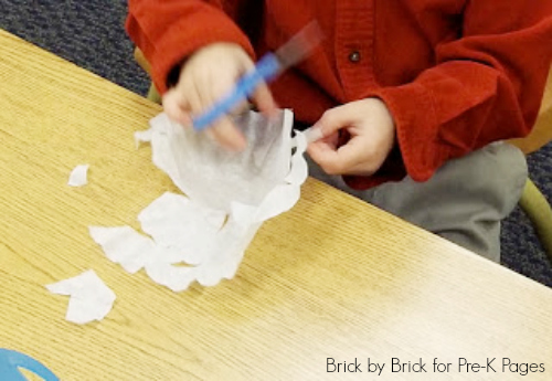 cutting snowflakes